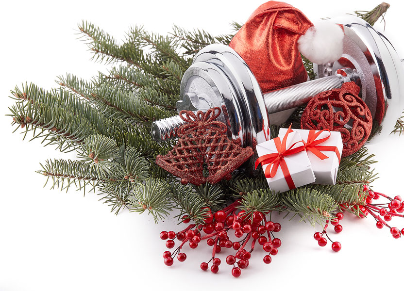 Dumbbell and fir tree branches